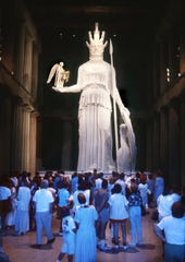 A crowd views the Athena statue, which made its debut at its home inside the Parthenon in Centennial Park on May 20, 1990.