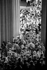 Thousands enter the Parthenon in Centennial Park on May 20, 1990, to view the 42-foot-tall Athena, which took Nashville sculptor Alan LeQuire eight years to create.