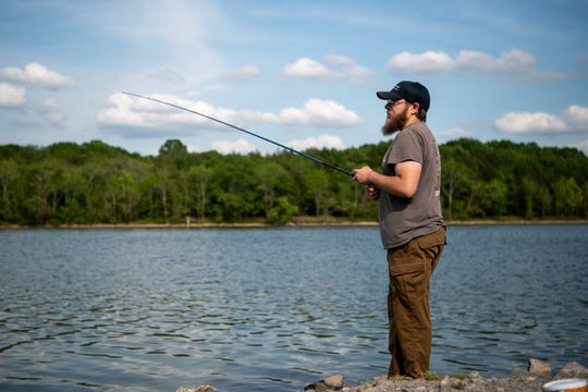 Vincent Palmisano, of Mt. Juliet, Tenn., fishes at Percy Priest Lake in Nashville, Tenn., Friday, May 15, 2020.