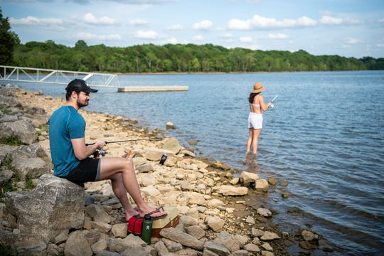 John and Kassidy Slaven, of Nashville, fish at Percy Priest Lake in Nashville, Tenn., Friday, May 15, 2020.