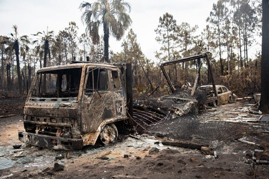 Guillermo Mesa's neighbor lost their vehicles during the 36th Avenue South fire, Friday, May 15, 2020, in Golden Gate Estates.