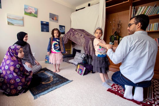 Stephanie Aspero, second from left, and her family – from right, Aspero's husband, Ahmad, and their daughters, Sarya, 5, Sennah, 5, and Ryanne, 10 – created a prayer space in their home during Ramadan.