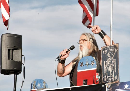 Terry Casaus speaks, Thursday, May 14, 2020, during a protest against business restrictions.