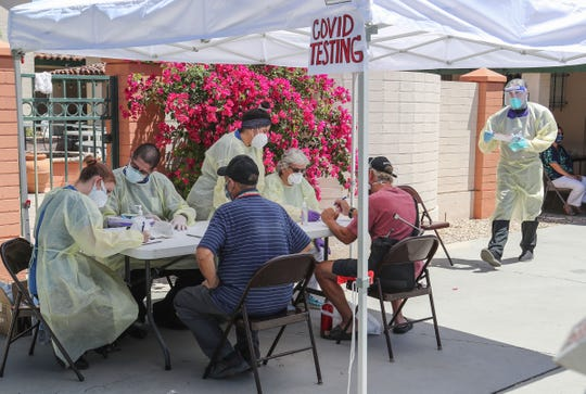 The Coachella Valley Volunteers in Medicine screen and test homeless individuals for coronavirus at Our Lady of Guadalupe Church in Palm Springs, May 15, 2020.