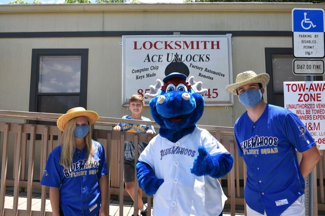 Blue Wahoos mascot Kazoo (center) with employees of the minor league baseball team on a recent trip to neighborhoods during the COVID-19 pandemic in May 2020.