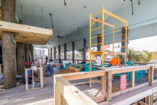 Work continues on Water Pig BBQ on Pensacola Beach on Friday, May 15, 2020. The new concept, featuring all outdoor seating and a 4,300-pound smoker, by Innisfree Hotels is located next to its sister restaurant Red Fish Blue Fish at 5 Via de Luna Drive and is expected to open in June.