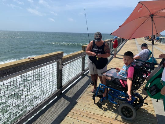 Leah Cortello and her 10-year-old son Kaden enjoy a day at the Navarre Beach Fishing Pier on Friday, May 15, 2020.
