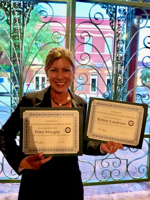 Rhea Kessler with the 2020 Dr. Alec Kessler Memorial Scholarship awards for Gulf Breeze's Britton Landrum and Pensacola Catholic's Peter Mougey. The 2020 Pensacola Sports banquet was held virtually at Seville Quarter in May 2020 due to the COVID-19 pandemic.