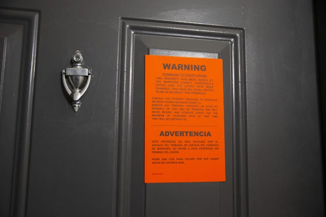 An eviction notice is served at an apartment.