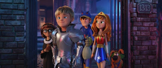 Velma (Gina Rodriguez), Freddy (Zac Efron), Shaggy (Will Forte) and Scooby-Doo (Frank Welker) in 'Scoob!'