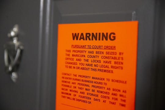 An eviction notice is served at an apartment in east Phoenix on May 15, 2020.