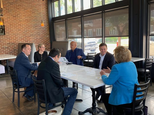 Gov. Doug Ducey posted photos on his Twitter account on May 14, 2020, showing him having lunch with several state legislators at a Phoenix restaurant. None were shown wearing masks while together.