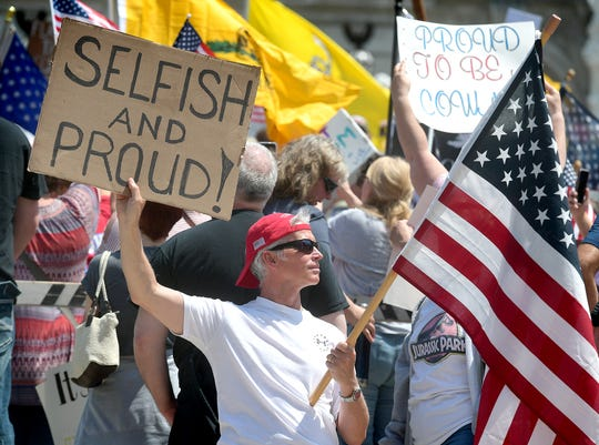 John Dahl of State College protests statewide shutdowns during a Reopen PA rally in Harrisburg Friday, May 15, 2020. About one thousand protesters participated at the rally in front of the capitol building. Bill Kalina photo