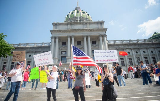 Thousands gather outside the Capitol building for a ReOpen PA rally in Harrisburg, Pa., on May 15.