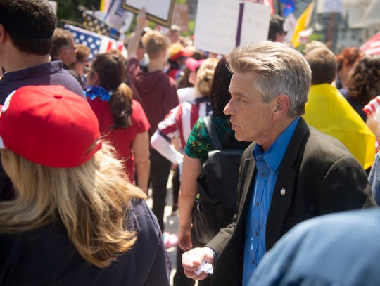 State Rep. Russ Diamond, R-Lebanon, walks among supporters in the crowd during the OpenPA Rally in Harrisburg on Friday, May 15, 2020. Rep. Diamond led off the speakers during the rally.