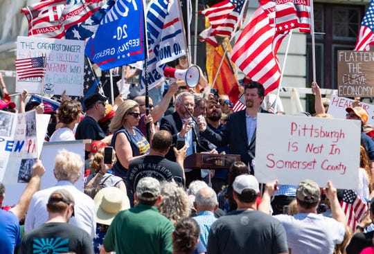 Thousands gather outside the capital building for the ReOpen PA rally in Harrisburg on Friday, May 15, 2020.