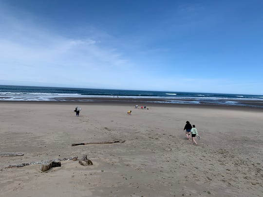 There were a smattering of people on the Oregon Coast beach in Lincoln City after D-River Wayside was reopened on May 15, 2020.