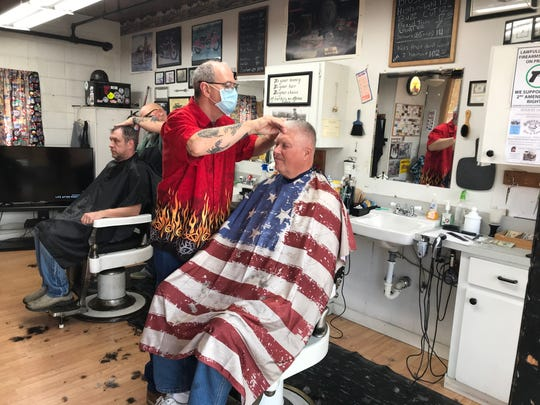 Barber Don Mack gives a fresh cut in McMinnville on Friday, May 15.