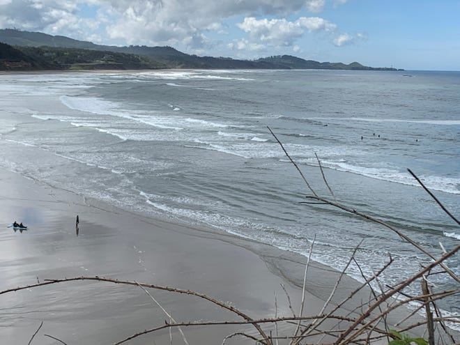 Surfers in the ocean found a way to reach the beach on Friday, May 15, 2020.