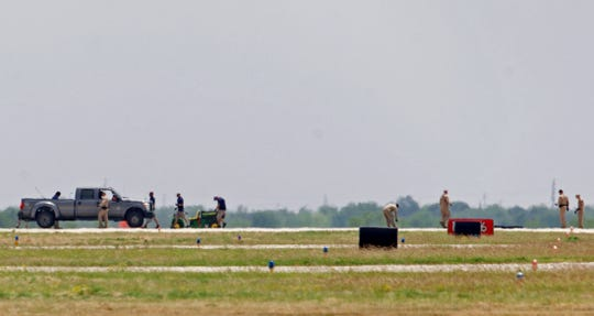 Emergency personnel near the scene of the crash of an unmanned aircraft at the San Angelo Regional Airport can be seen in this Friday, May 15, 2020 photo.