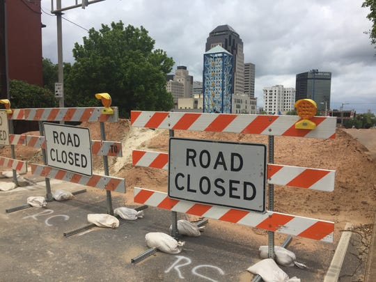 Piles of sand and roadblocks are seen on Friday in downtown Shreveport at the Spring Street Bridge.