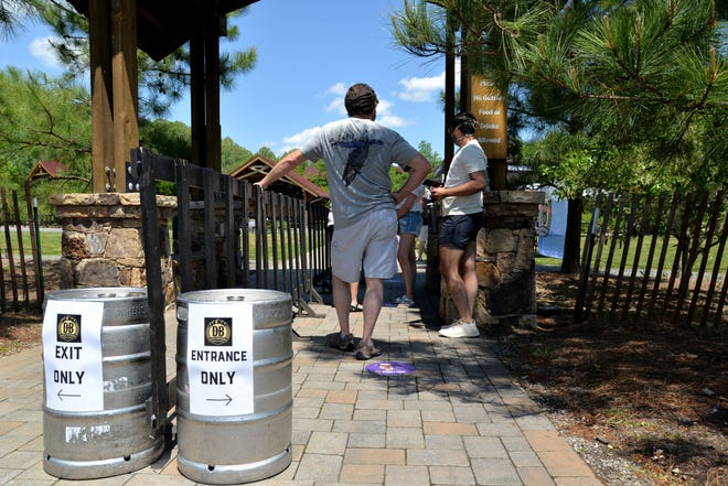 Local breweries, restaurants and vineyards with outdoors spaces opened up May 15 per Gov. Ralph Northam's Phase One of Forward Virginia. Here, Devils Backbone in Roseland had a reservations-only system and customers had to wear masks to get in.