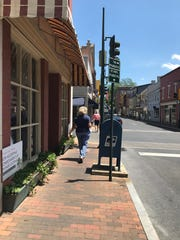 Visitors stroll down Beverley Street on Friday, May 15, 2020 in downtown Staunton.