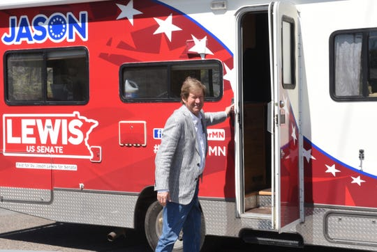 "U.S. Senate candidate Jason Lewis gets off his tour bus during his ""Reopen Minnesota for Business"" tour Friday, May 15, 2020, in St. Cloud."