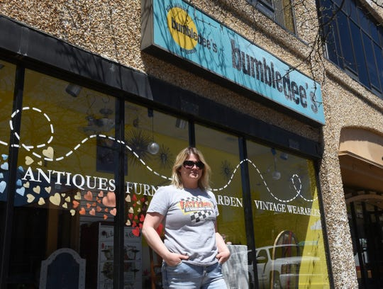 Bumbledee's owner Echo Nelson poses for a photo in front of her store Friday, May 15, 2020, in St. Cloud.