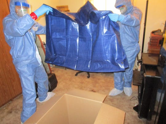 Jonathan Webb and Hyrum Taylor, of Red Desert Decon, preparing for a decontamination cleaning project.