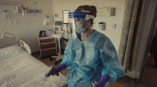 Care givers at Dixie Regional Medical Center wear protective equipment Tuesday, May 12, 2020.
