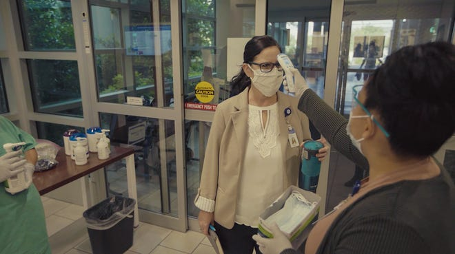Employees at Dixie Regional Medical Center are checked for masks and temperatures on their way into work Tuesday, May 12, 2020.