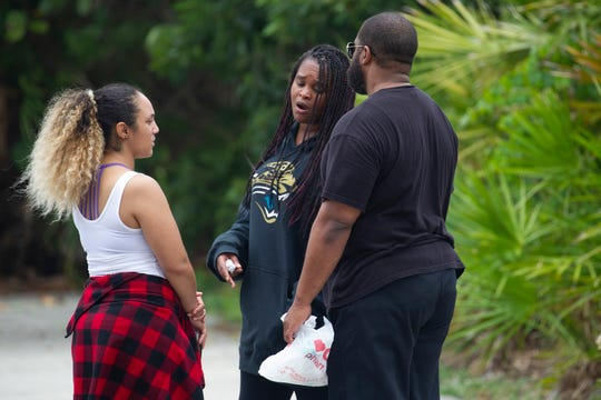"Vanessa Williams (left), of Jacksonville, aunt of missing Vero Beach High School senior Lenton ""Ty"" Ward, speaks with Ty's parents Deisha Brown (center), of Vero Beach and Lenton Ward, of Port St. Lucie, on Friday, May 15, 2020, in the parking lot at Dollman Park Beachside in Jensen Beach. Their son Ty was last seen in the water at Dollman Park Beachside with friends on Wednesday at 4:30 p.m., approximately 150 yards off the shore."