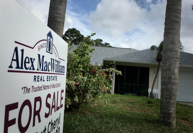 """Home sales are still continuing, shown by """"FOR SALE"""" signs in front of a property in the Vero Highlands."""