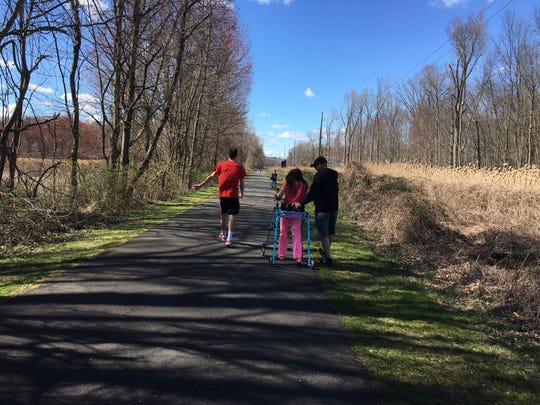 Keira Cunningham and her family take advantage of a sunny day in Tappan, NY. Cunningham has been in Blythedale's program since she suffered a stroke in 2017.
