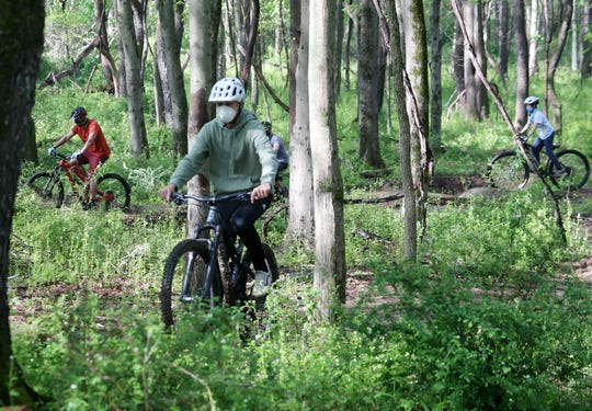 Mountain bikers enjoy the mountain bike course that was built in Graham Hills Park in Pleasantville May 15, 2020.