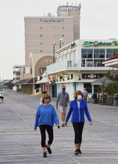 The beach and boardwalk were reopened in Rehoboth Beach on Friday morning to exercising, bike riding and dog walking with most early risers practicing social distancing and wearing masks.