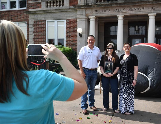 Debby Ford, center, is photographed with Wichita Falls ISD superintendent Michael Kuhrt and principal Chrissy Nash after Ford was chosen as the Secondary Teacher of the Year Friday morning.
