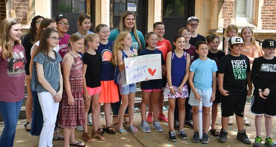 Ben Franklin Elementary teacher Courtney Kittrell is pictured with her students after being named the Elementary Teacher of the Year Friday morning at Ben Franklin Elementary.