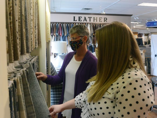 Customers look at color patterns on Thursday at Coconis Furniture in South Zanesville. The 70,000-foot facility is among many retail stores now allowed to open to the public.