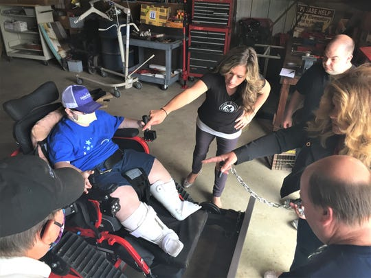 13-year-old Cameron Achauer received an Action Track Chair from Make a Wish foundation Friday. The new power chair will allow him to get around  in all terrain so he can hunt and fish. The chair was also equipped with a snow plow so Cameron can make extra money.
