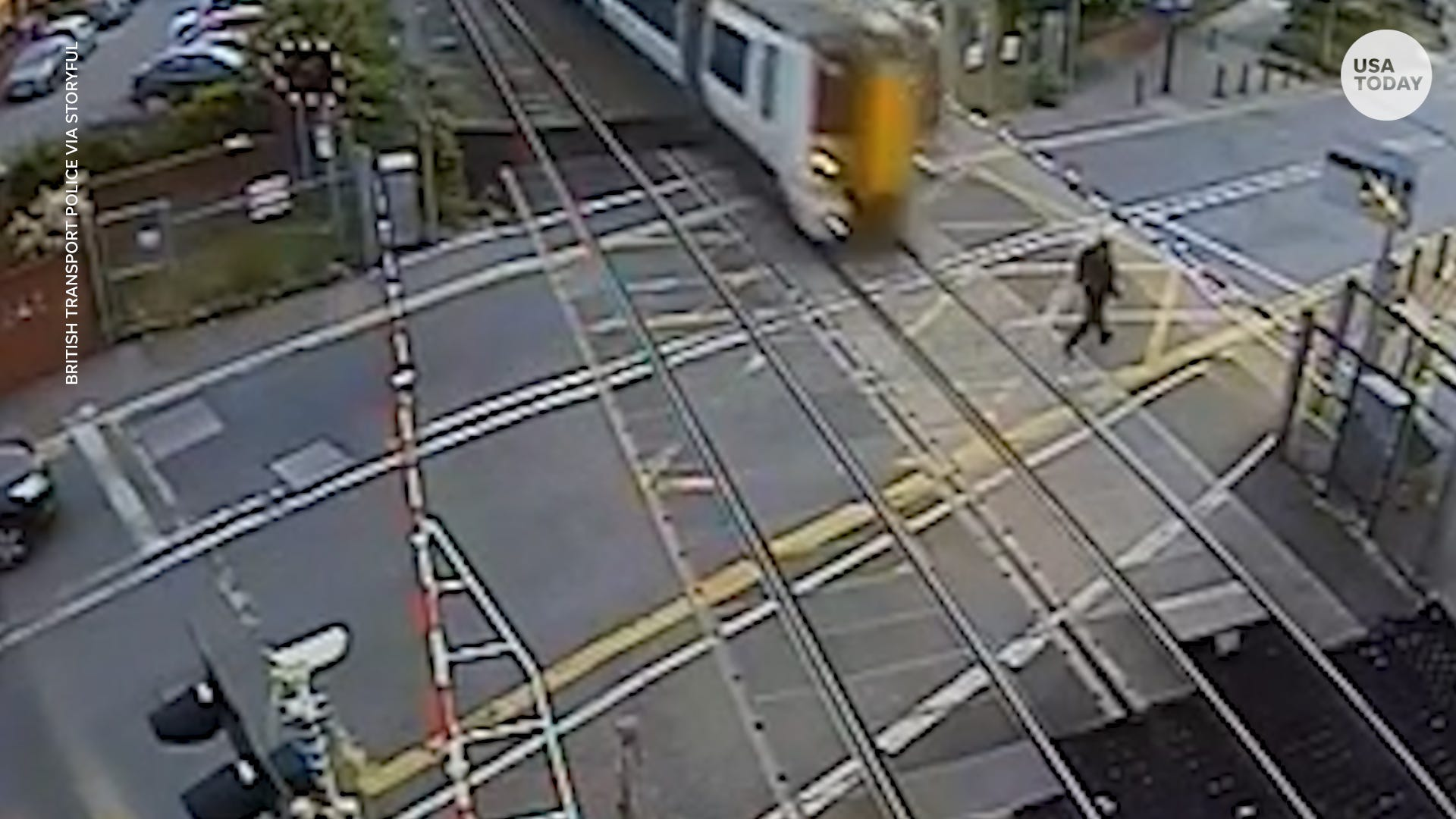 Man Almost Hit By Train After Climbing Over Crossing Barrier
