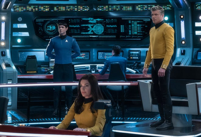 """Mr. Spock (Ethan Peck), left, Number One (Rebecca Romijn) and Captain Pike (Anson Mount) will be featured in CBS All Access' """"Star Trek: Strange New Worlds,"""" which follows the adventures of the U.S.S. Enterprise in the years before Captain Kirk."""