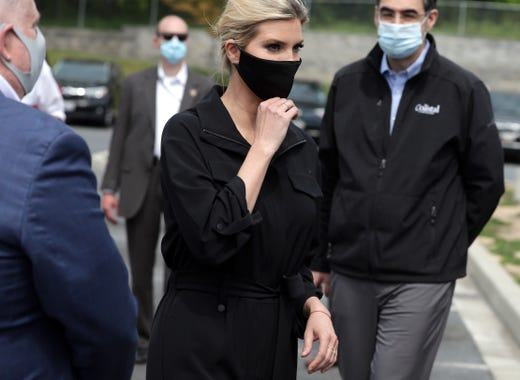 Ivanka Trump, first daughter and adviser to President Donald Trump, adjusts her mask after a tour at the distribution center of Coastal Sunbelt Produce May 15, 2020 in Laurel, Maryland.