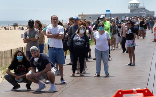 Both the boardwalk and the beach was crowded in Belmar Saturday as hundreds lined up to buy beach badges, and to enjoy the beach as well. Visitors observed social distancing rules for the most part, even when standing in line for badges.