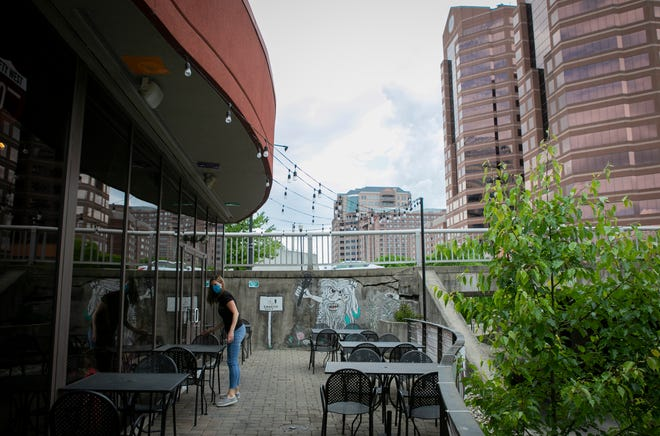 Kristin Steuber, co-owner of The Gruff, in Covington, situates the restaurant's patio on Saturday, May 16. Kentucky's restaurants can reopen their dining rooms as soon as May 22 Ñ but only at 33% capacity. Unlimited outdoor seating will also be allowed as long as customers are spaced out properly.