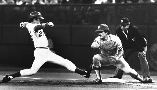 APRIL 18, 1981: Dave Collins stretches to get back to first base in the first inning Friday night against the Cardinals. Keith Hernandez awaits Lary Sorenson's throw.