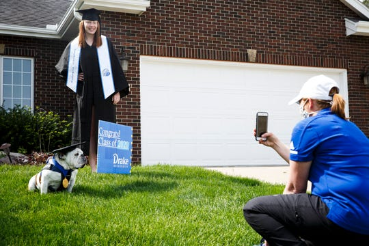 Erin Bell takes a photo of Griff and basketball standout Becca Hittner on Saturday, May 16, 2020, in Des Moines.  Griff was visiting some local graduates since Drake canceled its in-person commencement ceremony due to COVID-19 and is holding it online instead.