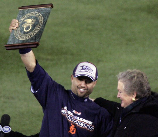 ALCS MVP Placido Polanco shows off his trophy to the fans in Comerica Park to celebrate after winning Game 4 in dramatic fashion and advance to the World Series on Magglio Ordonez's three-run homer on October 14, 2006.
