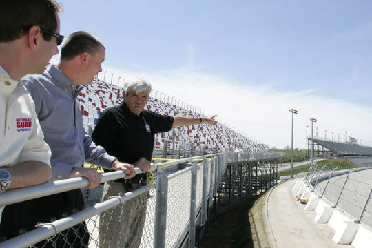 In this April 5, 2006 photo, NASCAR driver Greg Biffle, left, Darlington Raceway President Chris Browning, center, and Harold Brasington Jr. look out over Darlington Raceway in Darlington, S.C. Brasington Jr.'s father was the track builder. The 70-year-old raceway will host the return of NASCAR Cup Series racing, among the biggest events so far as sports makes a halting comeback from a global shutdown forced by the coronavirus pandemic.